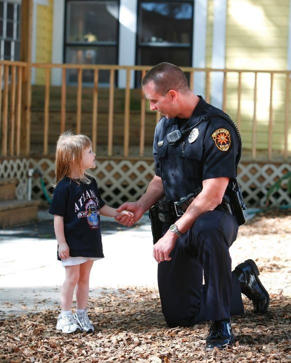 Officer with young child